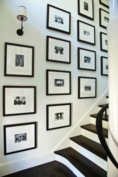 entrances/foyers - Thomas O'Brien Vendome Single Sconce black white photos black gallery frames staircase art gallery glossy black staircase railing