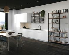 Hafele's YouK shelf system is ideal for use in living spaces, kitchens, and offices as a wall unit or in bathrooms for extra storage. It's extremely easy to assemble with just a few steps and is suitable with wood shelves (not included, customer supplied). The YouK ladder shelf system has welded frame connections that provide clean lines without divisions and simple, logical grids for effortless planning and installation.  #shelf #shelves #wallshelf Kitchen Shelves, Wood Shelves, Kitchen Storage, Storage Spaces, Kitchen Organization, Floating Shelves, Shelf System, Shelving Systems, Open Shelving