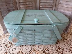 Upcycled picnic basket, painted, embellished with an image transfer, and lined with a vintage tablecloth