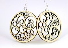 """Made In U.S.A Style # 1002 Size 1.8"""" x 1.8"""" Circles N' Circle Earrings A circle is a simple shape of Euclidean geometry that is the set of all points in a plane that are given the distance from a given point, the centre.  Made from sustainably sourced materials Laser-cut wood Stained with water based dye Ear wires are silver-finished 3041 stainless steel with new electrophoretic-coating that resists tarnishing"""