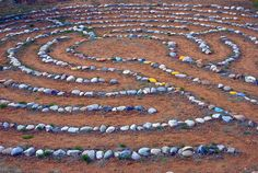 labyrinth at grade school by wplynn, via Flickr This is fabulous. An ordinary stone labyrinth transformed by children who painted the stones various colours. This is now on my bucket list - so much fun for the kids to build this!