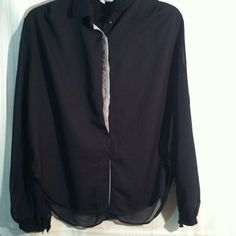 Sheer split back blouse Navy blue sheer blouse. Gray trim on buttons , button cuffs. Arms at sheer , front is more solid not so sheer. Collared and button up front. The back is sheer and splits down middle. Very nice top. Lumiere size small. Smoke and stain free excellent shape Lumiere Tops