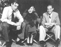 Gary Cooper with Jean Arthur and Frank Capra on the set of Mr Deeds Goes To Town