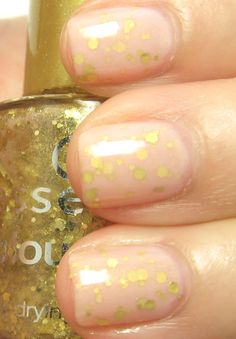 Jelly sandwich manicure - gold glitter between two layers of a nude jelly.  Pretty!