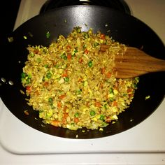 Chicken Fried Rice 2 cups cooked rice,1/4 cup rotisserie chicken shredded into small pieces 1/2 cup frozen peas and carrots 1/2 cup chopped white onion 2 eggs 2 tables oil ( I used veg oil but you can use sesame oil 1/8 cup soy sauce Heat oil over medium heat, add onion peas and carrots and stir fry until tender. Then add eggs and scramble making sure to mix thoroughly with the veggies. Add chicken and rice stir. Then add soy sauce, stir together and remove from heat.