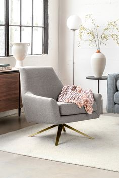 This angular, mid-century shape is anchored by gold metal swivel legs and dressed up in retro tweed. Swirl your cocktail with an arched eyebrow. #LivingRoom #LivingRoomFurniture #LoungeChair #InteriorInspo #InteriorDesign