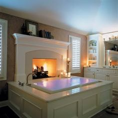 A bathtub in front of a fireplace! Yes please