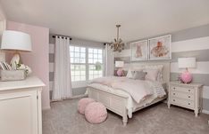 Striped gray walls and pink decor are the perfect match in this beautifully designed girls bedroom. | Pulte Homes #DIYHomeDecorForGirls