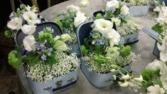 Baby's Breath and a small vase filled with Lisianthus, Tweediaand Viburnum