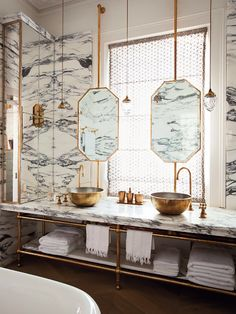 bathroom, marble, floating mirror, gold mirror, gold pendants, gold vessel sinks