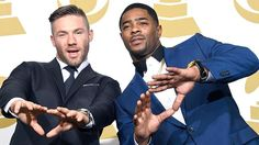 Julian Edelman and Malcolm Butler pose during The 57th Annual GRAMMY Awards.