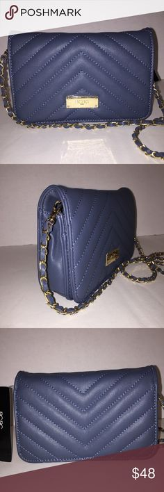 """🆕BCBC PARIS BLUE QUILTED CROSSBODY BAG BCBC PARIS QUILTED CROSSBODY BAG  HANDBAG  STYLE:B-0220 F34  COLOR: DUSTY BLUE  RETAIL: $98.00  ~NEW WITH TAG~    BCBC PARIS ELEGANT CHANEL INSPIRED STYLE QUILTED CROSSBODY HANDBAG, FAUX LEATHER.  DETACHABLE STRAP WITH GOLD TONE CHAIN & FAUX LEATHER  BCBG GOLD LOGO PLATE HARDWARE    FRONT FLAP SNAP CLOSE  OPEN COMPARTMENT  INTERNAL ZIPPER POCKET  CREDIT CARD SLOTS  OPEN POCKET  INSIDE LINING  Measurements: 5"""" X 7.75"""" X 2"""" Strap Drop 38""""   🚫NO…"""