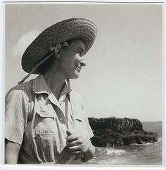 "Harold Stein, a family friend of ""Georgia O'Keeffe's Hawai'i"" author Patricia Jennings, took this snapshot of the artist on Leho'ula Beach near 'Aleamai in Maui's Hana district in 1939. O'Keeffe bought the straw hat at Hasegawa General Store so she could paint outside, but had to borrow a strip of cloth from 12-year-old Patricia so she could keep the hat tied to her head in the wind."