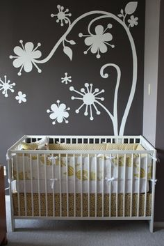 Cute bedding for a yellow and gray nursery.