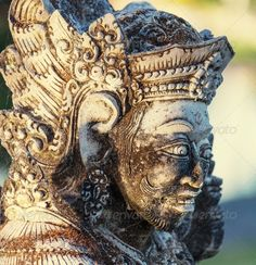 Statue in Bali ...  Balinese, ancient, architecture, art, asia, asian, bali, buddha, carved, close-up, culture, decoration, detail, exotic, face, god, handicraft, handiwork, hindu, historic, idol, indonesia, indonesian, island, locally, majestic, monument, mysticism, myth, old, orient, oriental, outdoor, park, portrait, religion, sculpture, statue, structures, symbol, temple, traditional, travel, trunk, vacation, warrior, wood, woodcarving, woodcutting, worship