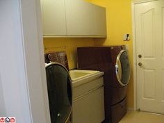 Laundry room and access to garage Stacked Washer Dryer, Washer And Dryer, Laundry Room, Washing Machine, Garage, Home Appliances, House, Carport Garage, House Appliances