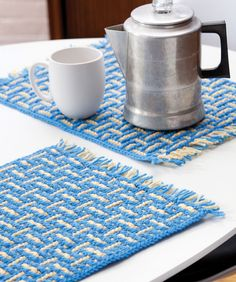 Bring your crocheting skills to the table with this pretty two-color set. These no-shaped pieces are small enough to make it fun to try out a new stitch technique.