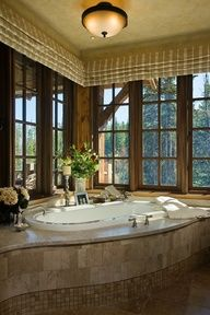 tile bathtup for simple finish. add greenery outside windows.