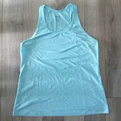 """Nike Dri-Fit regular fit tank top LARGE Size LARGE - Nike Dri-Fit regular fit tank top in Aqua/light blue. Small Nike """"swoosh"""" on bottom on tank.  Only worn a few times -  in perfect condition and perfect for running, CrossFit, or any other workout!  100% polyester - made in China. Nike Tops Tank Tops"""