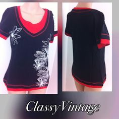 Black and red cotton top Black and red cotton knit top. Black with red trim and white floral print. Short sleeves - made in India and runs true to size. Boutique Tops