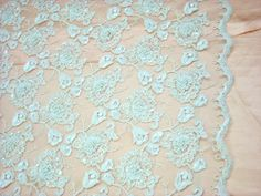 """Lace -Beaded Alencon Lace in Ivory. Polyester & Rayon. Dry clean. 50"""" wide. Sold by the yard."""