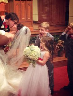The flower girl and ring bearer's reaction to the groom kissing the bride... Ahhhh!