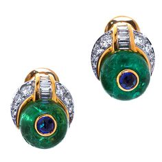 BULGARI Columbian Emerald Earrings. 18 karat gold and cabochon emerald of Columbian origin earrings inlaid with brilliant cut sapphires with a crescent diamond accent. 20th century