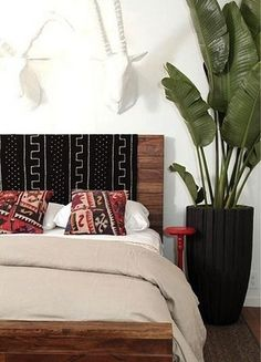 Possible weekend DIY: Simple wood headboard with mudcloth. Love this!