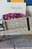 A wheelbarrow filled with confetti sat outside the church in preparation for the happy couple's exit.
