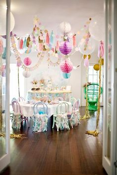 glam party - love the multi-color garlands used in this space!