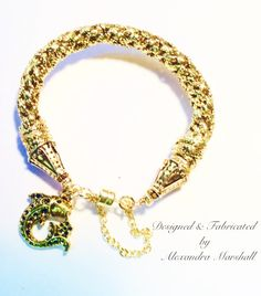 Kongo braided gold cord bracelet by Alexandra Marshall with 14K gold over pewter, magnetic clasp, safety chain, and your choice of size & themed bauble charm. $39. Contact me with size and charm preferences. Double click photo to visit my web store.