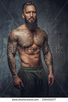 thumb1.shutterstock.com display_pic_with_logo 212824 335455277 stock-photo-tattooed-muscular-man-with-beard-in-stripes-panties-posing-in-shadows-over-grey-background-335455277.jpg