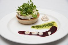 Warm pear & goat's cheese tart drizzled with a red wine dressing.