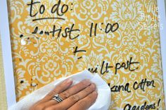 Easy DIY dry-erase board.  All you need is a picture frame with glass, some pretty scrapbook paper, and erasable markers.