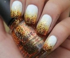 White nails dipped in gold glitter