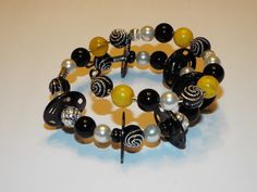Hey, I found this really awesome Etsy listing at https://www.etsy.com/listing/235101577/yellow-beaded-bracelet-bumble-bee