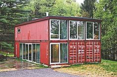 """Adam Kalkin's new home in Califon, N.J.    Kalkin's modestly sized, 1,920- square-foot Quik House sits atop a hill in the middle of three wooded acres. The first surprise was that such an alien, industrial form can look quite natural in such a rural setting, the """"rust bloom"""" exterior telegraphing """"color of nature"""" as strongly as the shape says """"man-made object."""""""