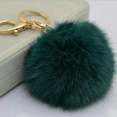 Faux Fur Pom Pom Keychain/Purse Charm This beautiful dark green pom pom keychain/purse charm is made from faux rabbit fur.  It easily clips onto any handbag or can be used as a key ring.     Measures 8cm in diameter Metal hardware is gold toned Accessories Key & Card Holders