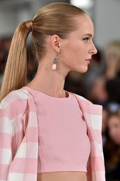 Ponytails went from high and sleek at Oscar de la Renta (left) to looser and lower at Gucci and Jason Wu to practically falling out at Rag & Bone.   - HarpersBAZAAR.com