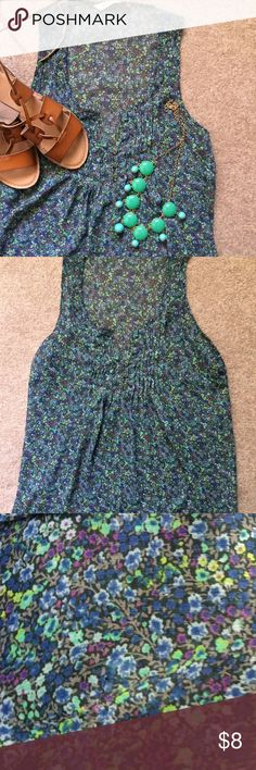 Old Navy Floral Tank Top! Lightweight floral tank top. Sheer look and 3 small buttons with pleats on top! Lots of beautiful colors of: blue, green, purple, and gray! Old Navy Tops Tank Tops