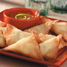 "Crispy Crab Rangoon Recipe -""My husband loved the appetizers we ordered at a Chinese restaurant so much that I was determined to make them at home,"" relates Cathy Blankman of Warroad, Minnesota. ""After two more trips to the restaurant to taste them again and about four home trials, I had them perfected."" TIP: ""I often make the filling earlier in the day to save time later,"" Cathy says."