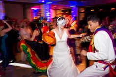 """We had an """"hora loca"""" (crazy hour) where we surprised guests with folk performers from Colombia (where my family is from), masks, noisemakers, beads, etc. It went a little nutty after that :)  Photos by www.harrison-stud..."""