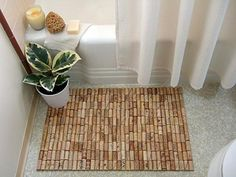 wine cork bathmat. so cool. & i think i'm becoming obsessed with wine cork crafts.