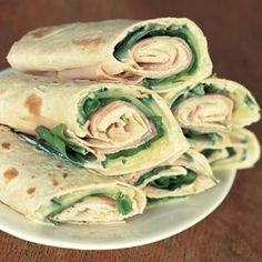Turkey wrap-  Sheet lavash bread, cream cheese, basil leaves, turkey, cucumber, fresh spinach leaves.....I might be able to get mike to eat these as well if I don't tell him they're healthy. =)