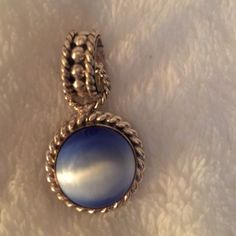 """Sterling Silver & Blue Pendant Sterling Silver & Blue Pendant. Approximately 3/4"""". Jewelry"""