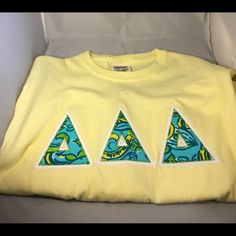 Delta Delta Delta Shirt-Yellow-Small Delta Delta Delta Tri-Delta Sorority Double Stitched Letter Shirt-Yellow -Size Small Greek letters in fashion fabric Shirt Color: Yellow Background: White twill Size- Small New! Ships in one business day! Comfort Colors Tops Tees - Short Sleeve