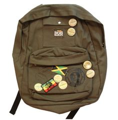 Officially licensed Bob Marley backpack featuring heavy canvas construction with two front accessory pockets, Bob Marley button, patches and screen printing to enhance style. Approximate measurements: 20 tall, 17 wide and 6 deep.