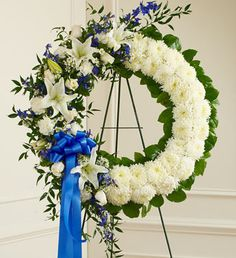 Serene Blessings Blue & White Standing Wreath With blue flowers that symbolize truth and white blooms that signify honor, this standing wreath arrangement beautifully reflects all the love and sympath Church Flowers, Funeral Flowers, Wedding Flowers, Flowers For You, White Flowers, Beautiful Flowers, 800 Flowers, Fresh Flowers, Funeral Floral Arrangements