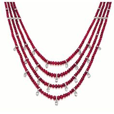 RUBY BEAD AND DIAMOND NECKLACE Composed of four graduated strands of ruby beads, decorated at the front with briolette diamonds set at random, interspersed by diamond-set rondelles, joined by similarly-set bar links and a clasp set with a double row of diamonds, the ruby beads together weighing approximately 407.25 carats and diamonds approximately 35.20 carats, mounted in platinum, length approximately 455mm.