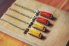 Harmonica necklaces. A must have this summer when you're out and about. Skills sold separately :)
